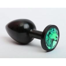 Чёрная анальная пробка с зелёным стразом - 7,6 см.